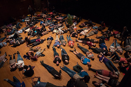 Students lie on the floor of Finney Chapel