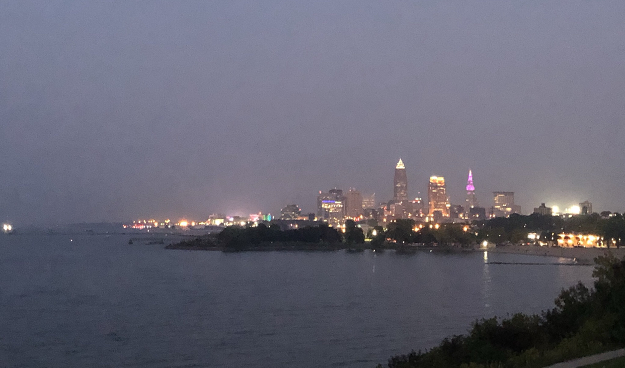 View from Edgewater Beach of the Cleveland skyline at dusk