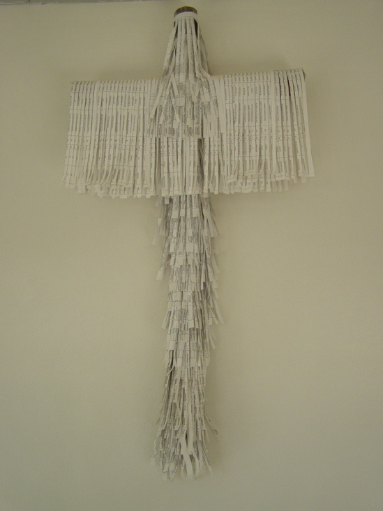 A cross made up of strips of paper