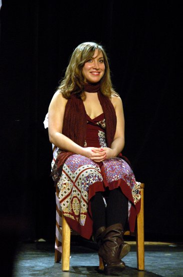 Elisa seated on stage