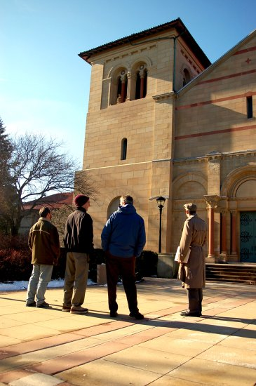 A group of men outside of Finney looking up at the bells