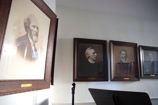 A row of old portraits of men