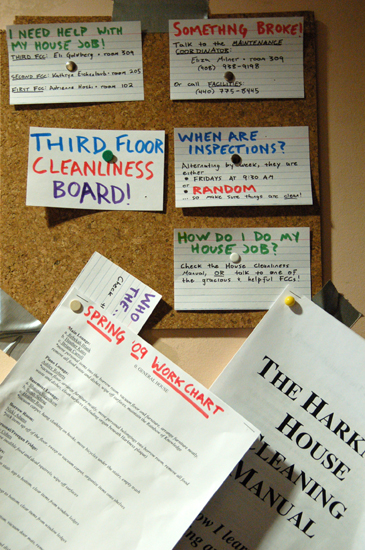A corkboard full of flash cards with cleaning instructions
