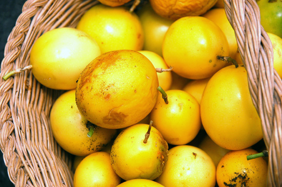 Basket full of yellow fruit
