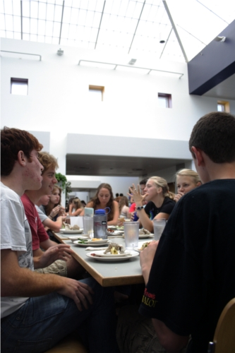 A group of students sitting at a table in Stevenson Dining Hall