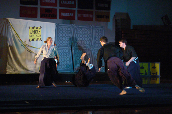 Performers doing martial arts
