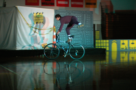 A performer doing tricks on a bike