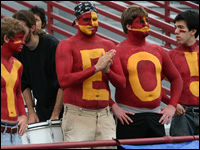 Fans with body paint spelling YEO