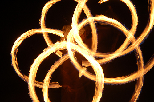 Student juggling rings of fire