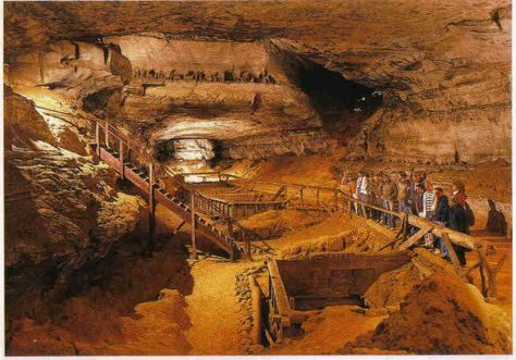 Painted depiction of the inside of large cave. A group of people stand at a built railing