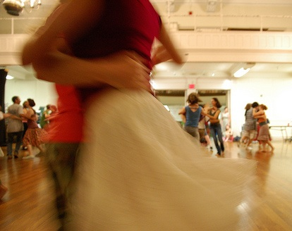 A contra dance couple mid-spin