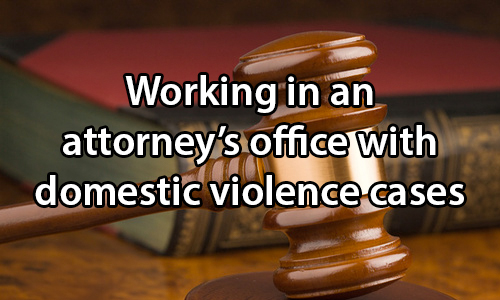 text: Working in an attorney's office with domestic violence cases. image: Gavel and book on a wooden desk