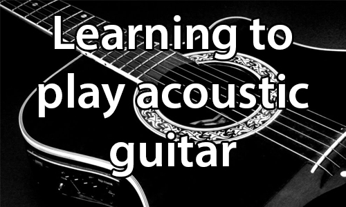text: Learn to play acoustic guitar. image: Image of a black and white acoustic guitar