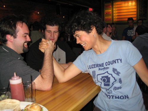 2 people arm wrestling.