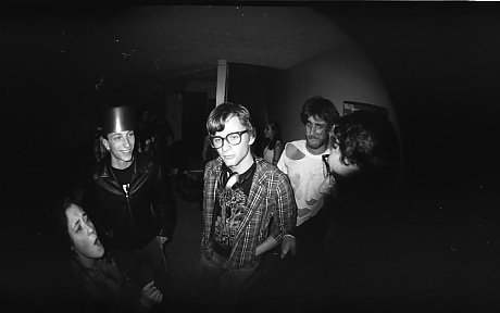 Fish-eye lense photo of a group of people at a party