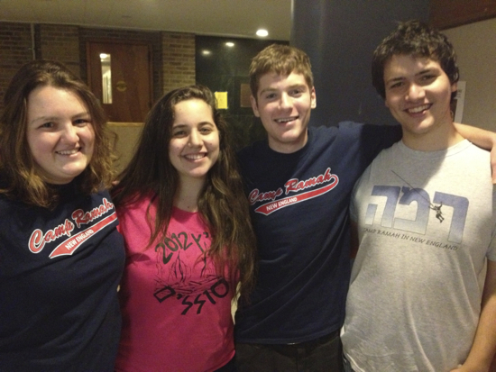 "Four students posing for a photo wearing ""camp Ramah"" shirts"