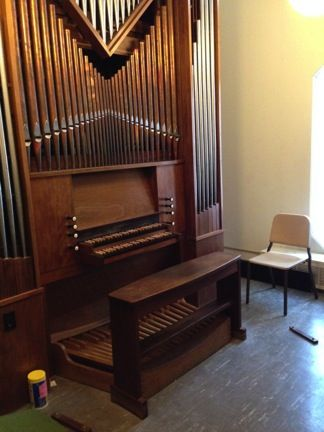 Small pipe organ in a sunny room