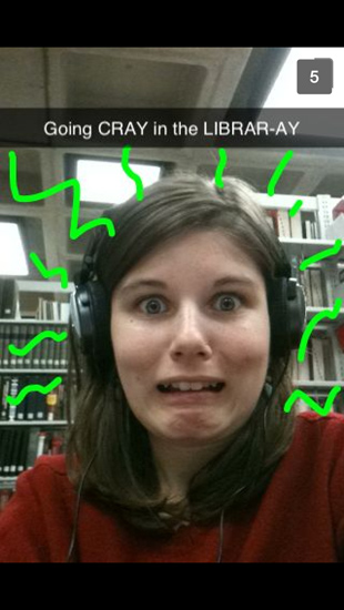 "Snapchat selfie with the caption ""going CRAY in the LIBRARY-AY"""