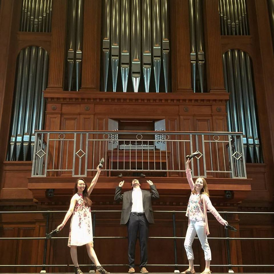 3 performers on the Finney stage under the organ