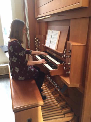 Student plays a practice room organ