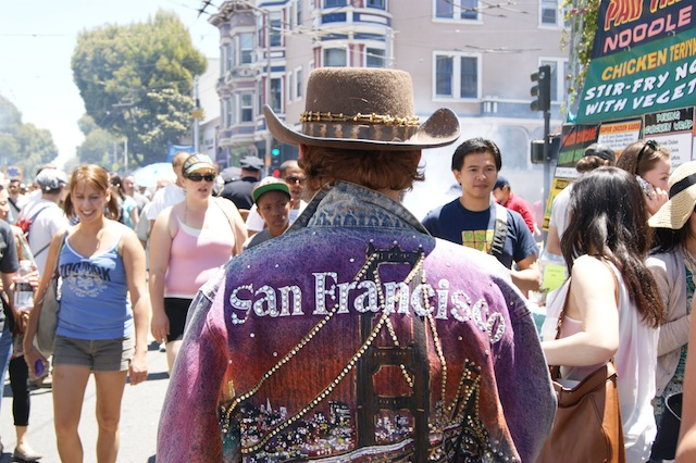 A man wearing a jean jacket with a portrait of San Francisco