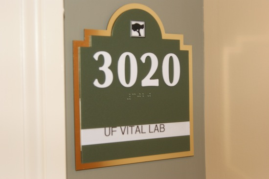 "An address next to a door with the words ""UF vital lab"""
