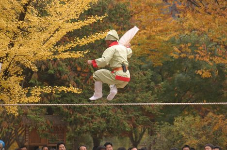 Person jumping on a tightrope