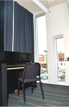 A practice room with a piano