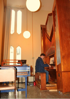A student practicing the organ