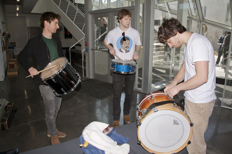 Students hold drums