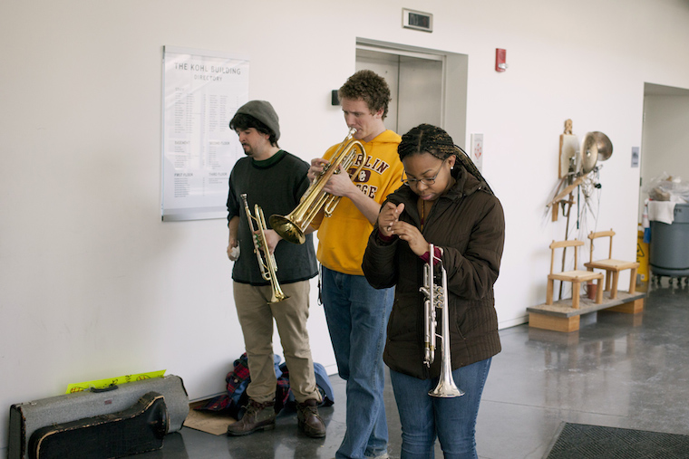 Students hold trumpets