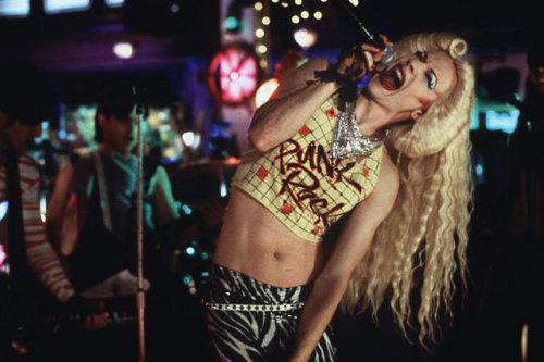 Punk singer in a long blond wig.