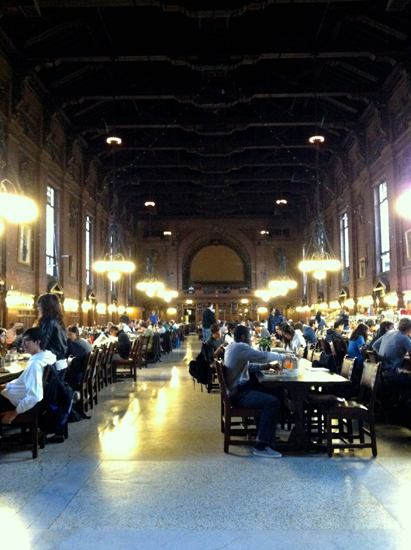 Dining hall with extremely tall ceilings and long tables