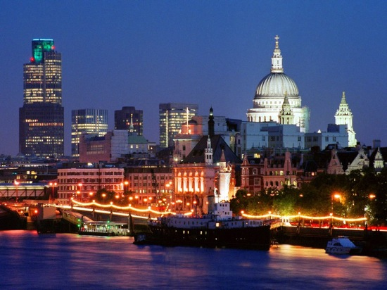 A night time view of the London skyline from the water