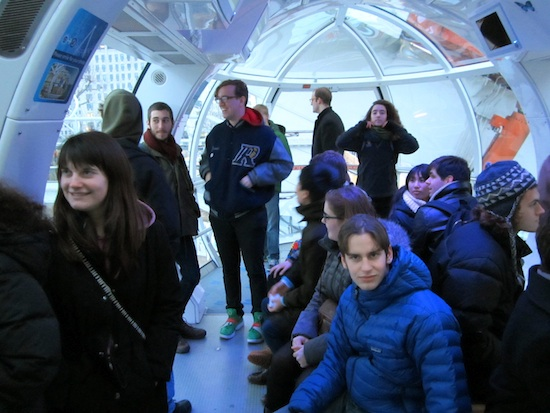 A group of students in an orb shaped glass room