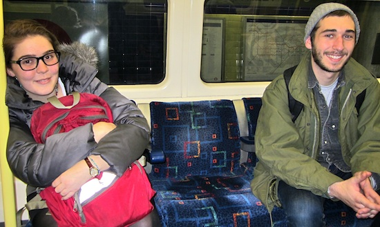 Two students sit on the train