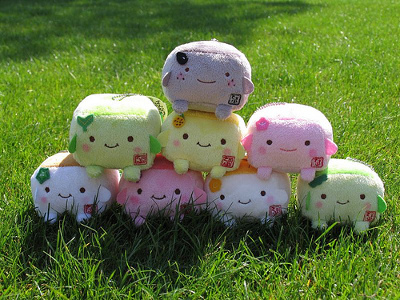 Tofu character plush toys stacked in a pyramid
