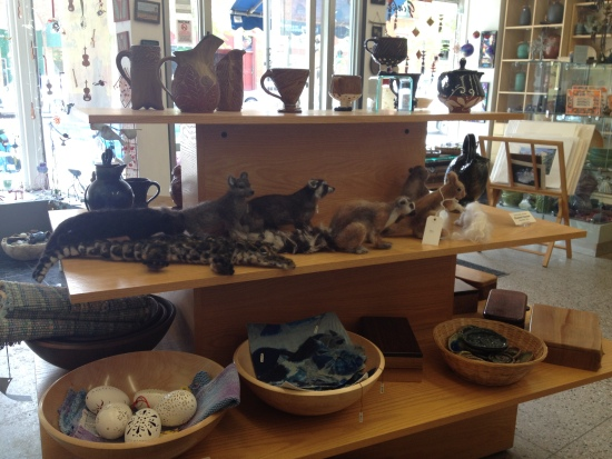 Pottery, animal sculptures, and other items for sale.
