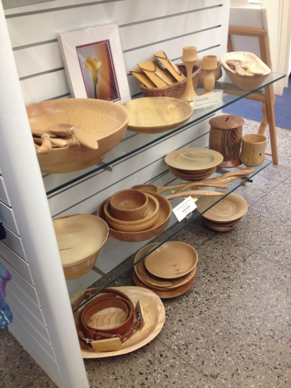 Store shelf with wood bowls and utensils