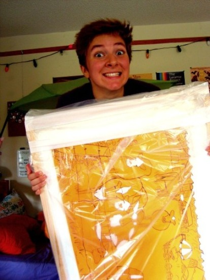 A person excitedly clutching a Matisse painting wrapped in plastic