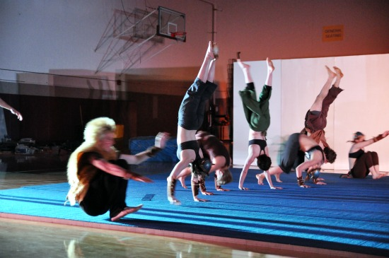 Students do handstands on a mat