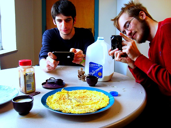 Students taking a picture of a giant omelette