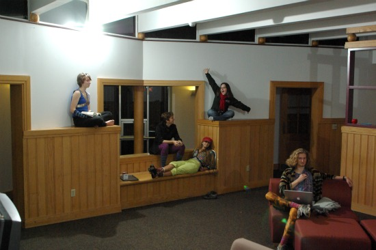 Students sit around a dorm lounge