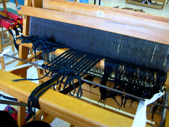 Tying the warp onto the loom