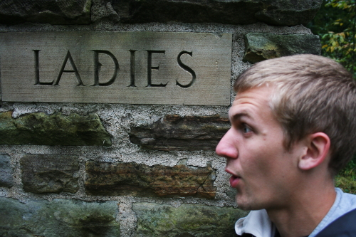 The word Ladies etched in a stone wall
