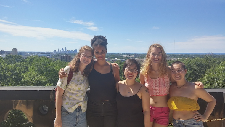 A group of women with the Cleveland skyline behind them