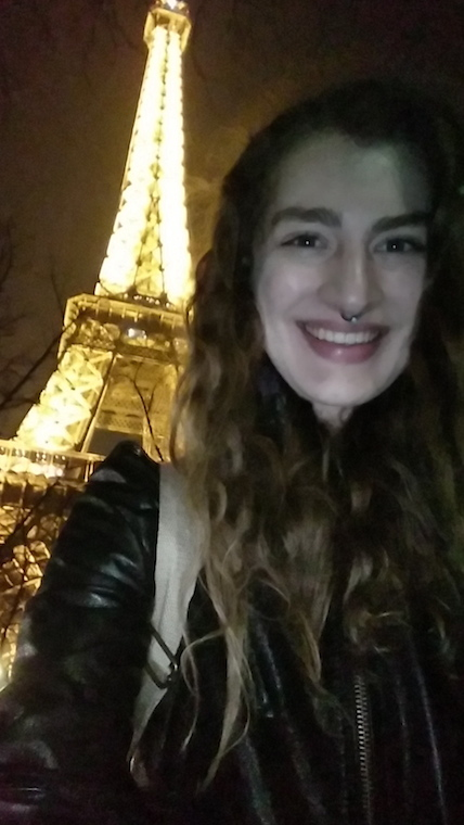 Writer takes a selfie in front of the eiffel tower at night