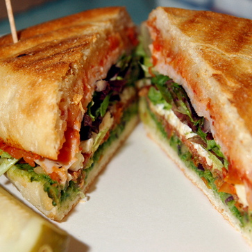 Panini with tomato, mozzarella, lettuce, and pesto