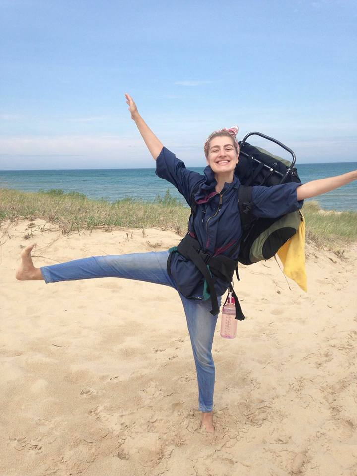 Author looking gleeful with hiking sack on back at the beach