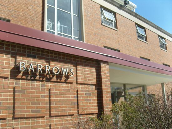 A sign on the front of a brick building says Barrows.